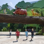Timon, Pumbaa and Simba taking a stroll through the courtyard